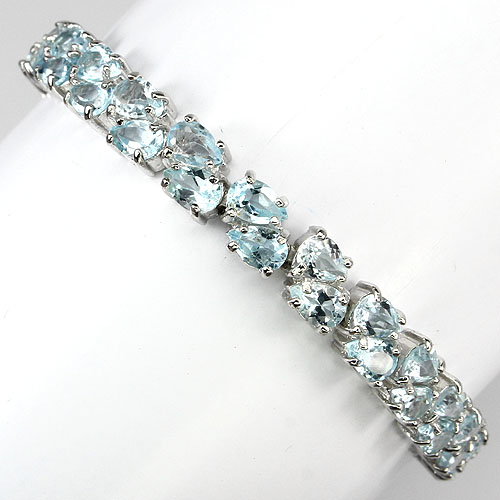 GEMSINOR Jewelry&Gems - 96CT. PRECIOUS NATURAL GEM PEAR 6x4mm/46pcs. TOP SKY BLUE TOPAZ 925 SILVER BRACELET